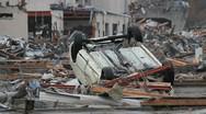 Japan Tsunami Aftermath- Car Overturned Stock Footage