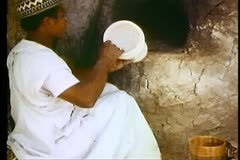 Young Egyptian puts an alabaster vase into the oven 108114 Stock Footage