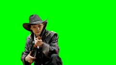 Huntsman fires the gun on the greenscreen Stock Footage