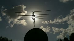 Solar flare rays tv antenna satellite dish Stock Footage