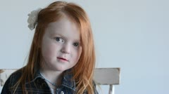 Young girl looking at camera, sad then happy 7673 Stock Footage