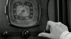 Vintage radio tuned cu, female BW Stock Footage
