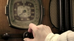 Vintage radio tuned cu, female Stock Footage