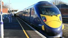 High speed train leaving the railway station Stock Footage