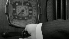 Vintage radio tuned cu, male BW Stock Footage