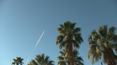 Jet Plane Flying Over Desert Palm Trees Time Lapse Stock Footage