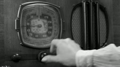 Vintage radio tuned, female BW - stock footage