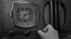 Vintage radio tuned, male BW Stock Footage