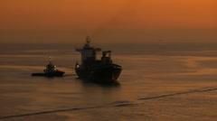 Sunset freighter malaga Stock Footage