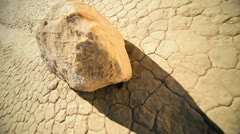 Cracked Earth Desert Valley Floor Moving Rock Stock Footage