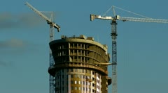 Skyscraper: cranes at work, time-lapse with zooming - stock footage