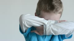 Young boy being shy 7675 Stock Footage