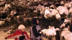 Snow From Tree Falling on Children - stock footage