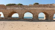 Archaeology acueducto caesarea historic aqueduct Israel roman arch building Stock Footage