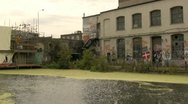 Stock Video Footage of Derelict warehouses on urban canal