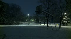 Basketball court at night during winter 2 - stock footage