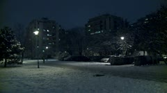 Snow in a park during the night 2 Stock Footage