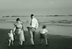 Family on beach--From 1930's film Stock Footage