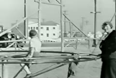 Kids at playground--From 1930's film Stock Footage