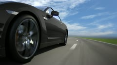 Black sport car moving on the road, loop-ready Stock Footage