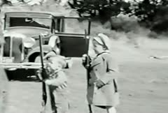 Stock Video Footage of Kids and rifles--From 1930's film