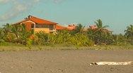 Tropical beach, luxury beach house Stock Footage