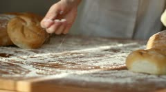 Baker hand throwing flour on the table and kneading dough, slow motion - stock footage