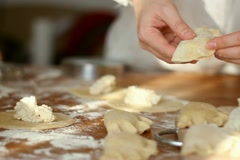Female hands preparing dumplings, tracking shot Stock Footage