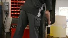 Mechanic doing a tire balance Stock Footage