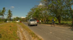 Cyclists on road, Panama, getting to work Stock Footage