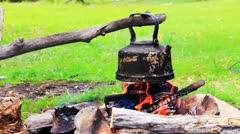 Smoky tourist kettle on fire in camping picnic Stock Footage