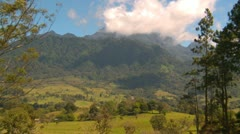 Late morning Volcan Baru and pastures zoom, Panama highlands Stock Footage