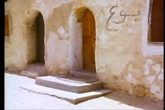 The Wadi Naturim Coptic Monastery, doors to the monks cells  108169 Stock Footage