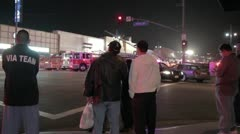 Bystanders watch firefighters at Work - stock footage