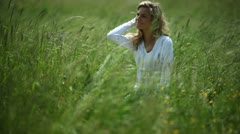 Young woman enjoying a windy day in the nature; Full HD Photo JPEG Stock Footage