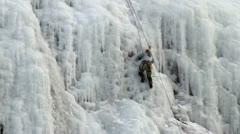 Ice climber man on mountain side Stock Footage