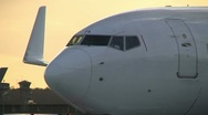 Taxiing plane at beautiful sunset Stock Footage