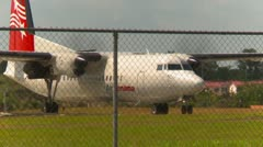Aircraft, Fokker F50 idle with traffic in FG, DAV Stock Footage