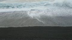 Waves washing up on black sand beach, Maui, Hawaii Stock Footage
