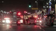Fire trucks block street with ladders extended Stock Footage