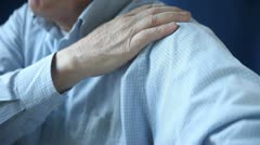 Businessman rubbing sore shoulder Stock Footage