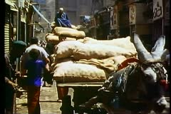Cairo Bazaar, the Khani Khailil, medium shot, donkey cart moves through - stock footage