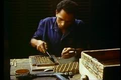 Cairo Bazaar, man solders brass work, medium wide shot Stock Footage