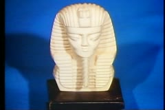 Stock Video Footage of Cairo Bazaar, shop interior, close up white alabaster pharaoh bust