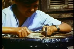 Cairo Bazaar, boy hammering silver inlay into plate, 3 shots, medium, close-up Stock Footage
