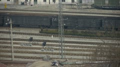 Long goods train traveling on railway,After railway station. Stock Footage