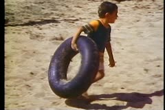 Alexandria, beach, close up boy with inner tube - stock footage