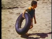 Stock Video Footage of Alexandria, beach, close up boy with inner tube