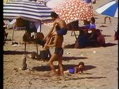 Stock Video Footage of Alexandria, beach, one man carries boy atop shoulders, medium shot