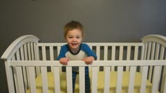 Toddler jumping in crib 7521 Stock Footage